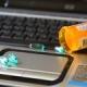 Picture of a bottle of prescription pills on top of a laptop keyboard